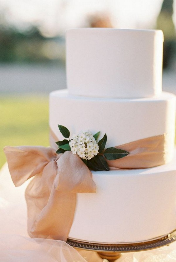 elegant wedding cake with blush ribbon