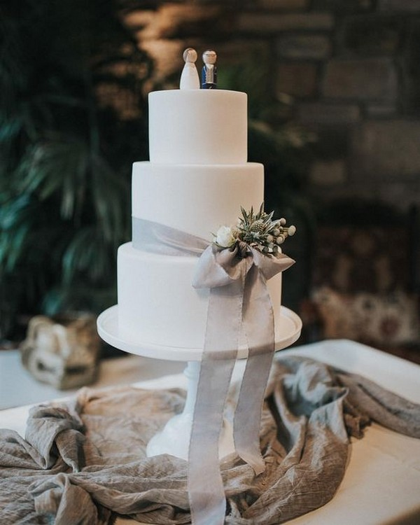 elegant wedding cake with gray ribbon