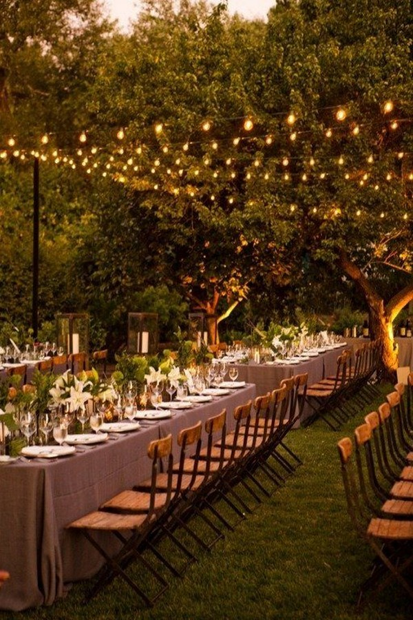 outdoor night wedding reception with lights