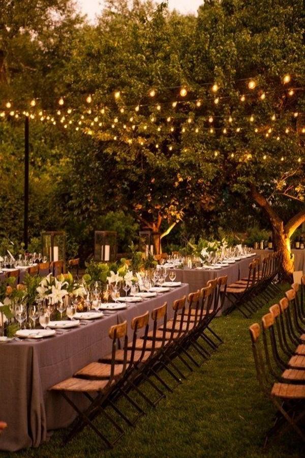 outdoor night wedding reception with lights