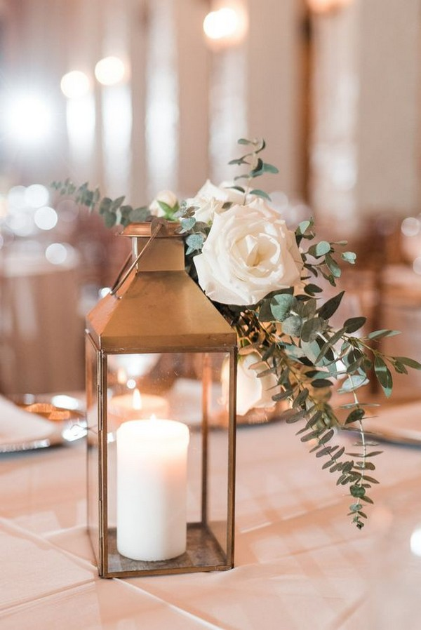 simple elegant winter wedding centerpiece with lanterns