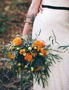 whimsical wedding bouquet with orange dahlias