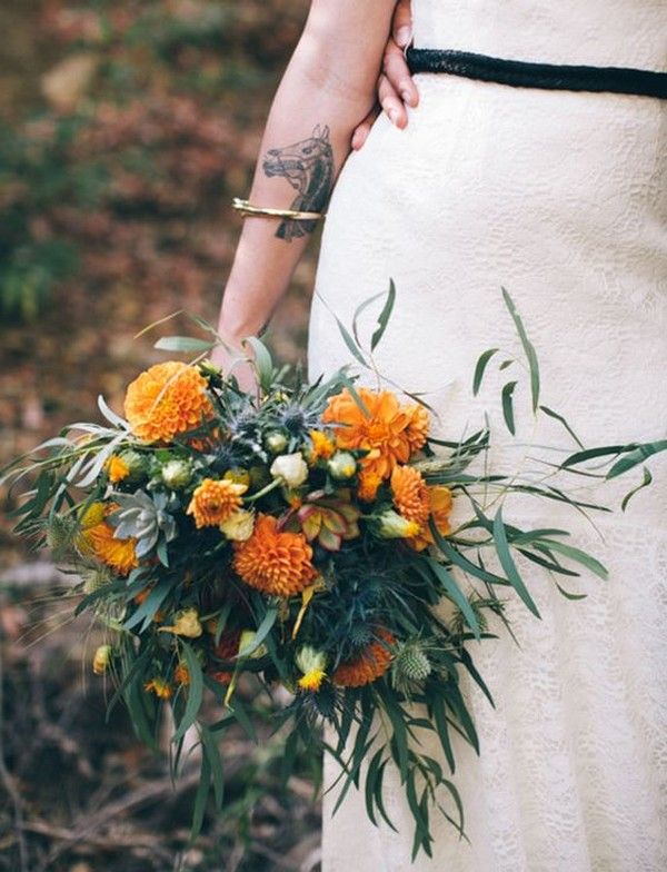 whimsical wedding bouquet with orange dahlias