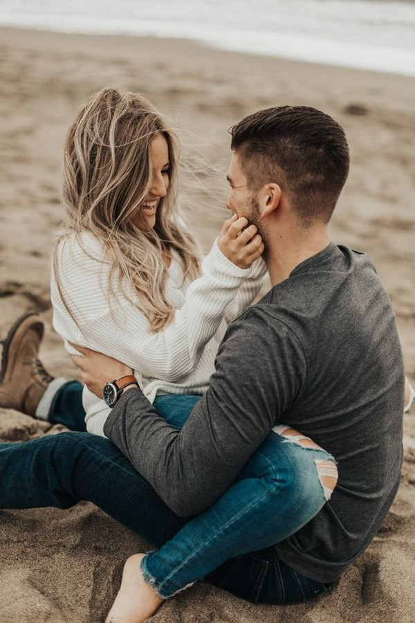 windy beach engagement photo ideas