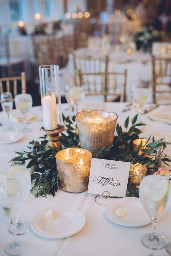 winter greenery wedding centerpieces with candle lights