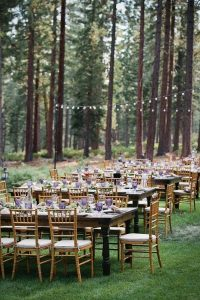 Enchanting wedding reception dinner in the woods
