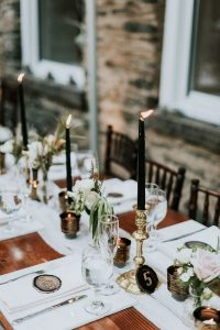 Gold candlesticks with black taper candles wedding decoration ideas