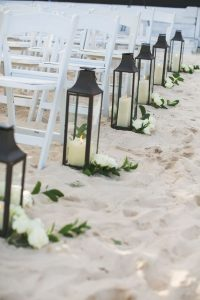 beach wedding aisle decorations with lanterns