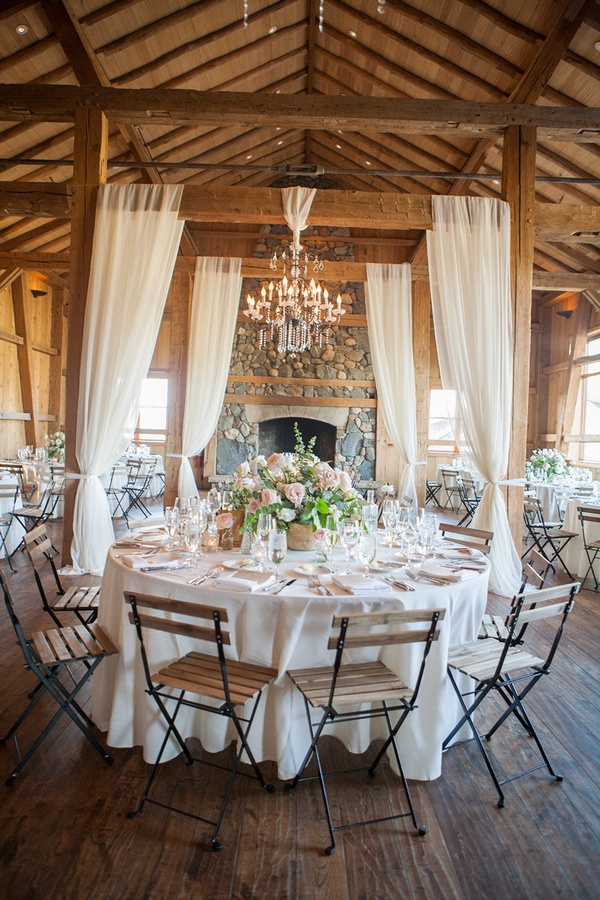 chic rustic barn wedding reception with fabric draping