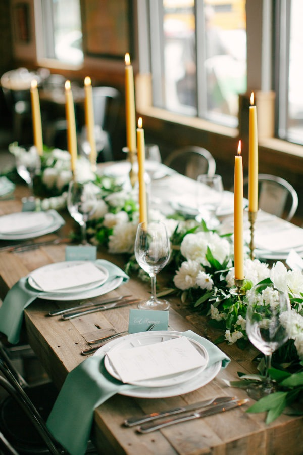 chic sage green wedding table decoration ideas with yellow taper candles