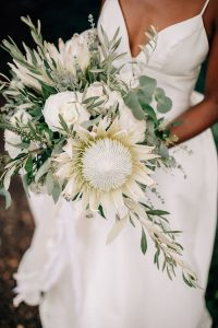 chic white and green wedding bouquet with protea