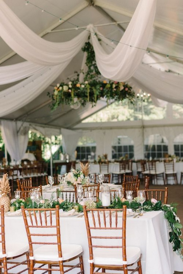 elegant tent wedding reception ideas with greenery and white draping