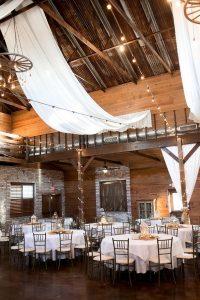 fabric draped barn wedding reception with string lights
