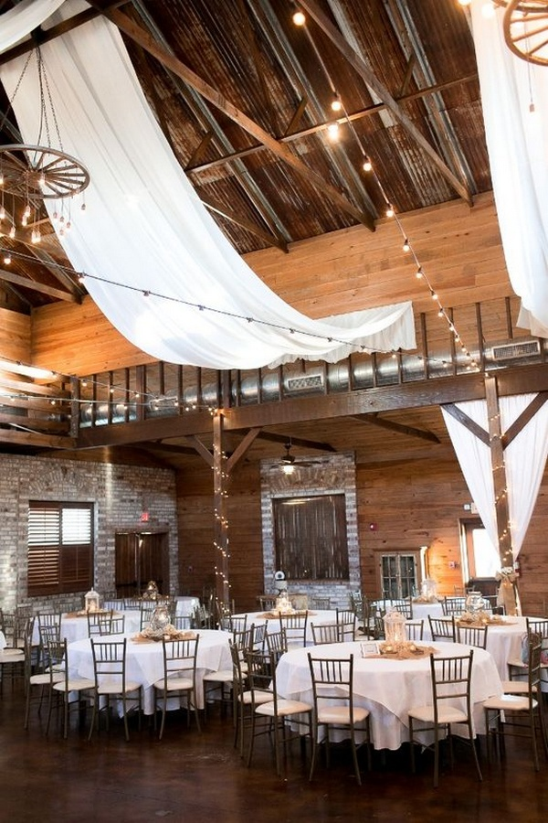 fabric draped barn wedding reception with string lights