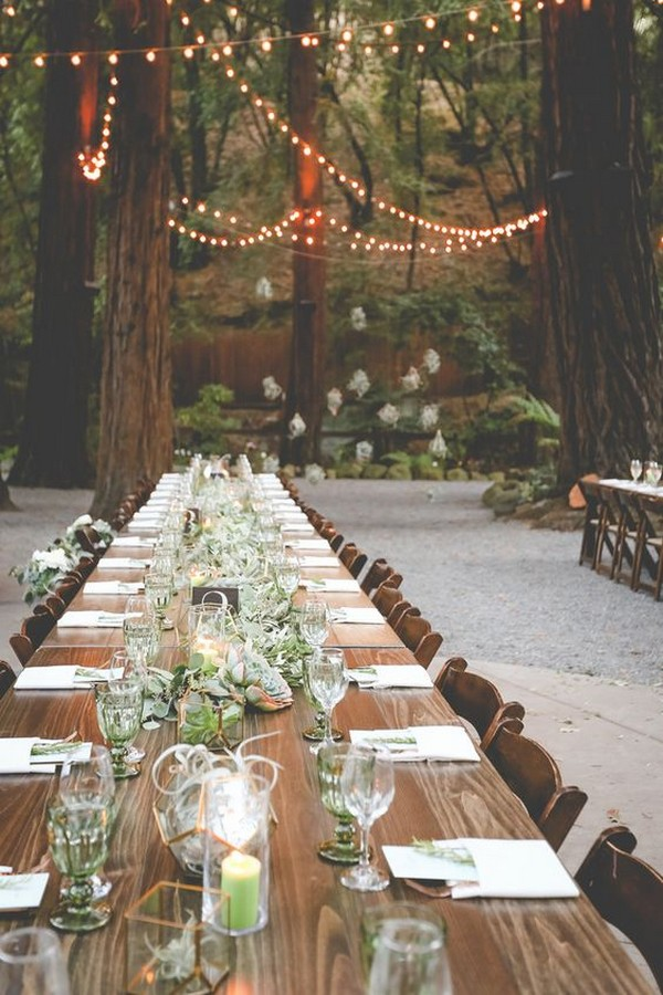 forest themed wedding reception with lights