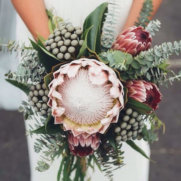 greenery and dusty pink wedding bouquet with proteas