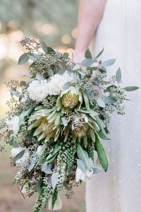 greenery wedding bouquet with king protea