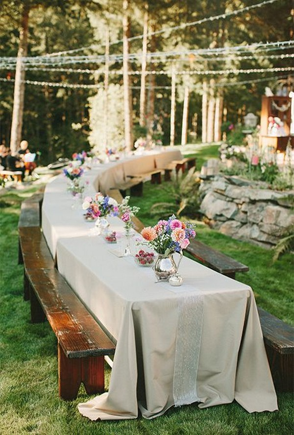 long table wedding reception in the forest
