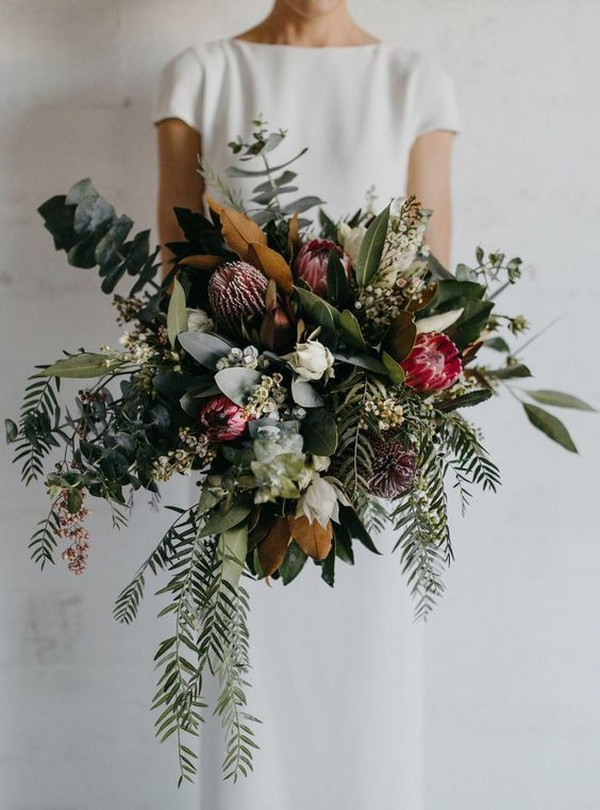 moody greenery and burgundy wedding bouquet with proteas