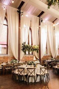 romantic wedding reception with ivory draping