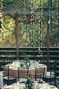 round table wedding reception ideas with lanterns in the forest