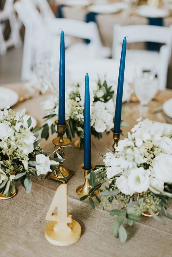 vintage wedding centerpiece ideas with blue taper candles