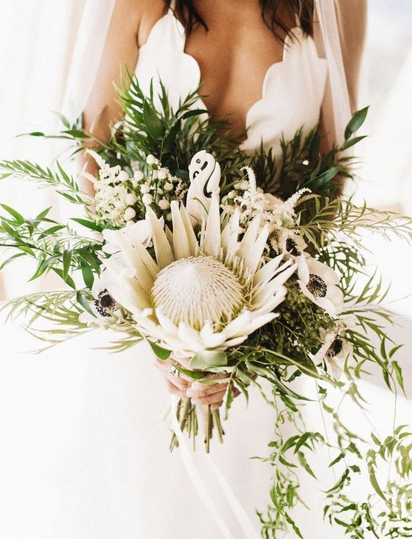 white and greenery wedding bouquet with king protea