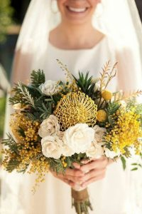 yellow and green wedding bouquet with protea
