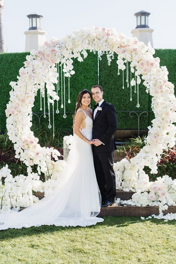all white flower circular wedding arch