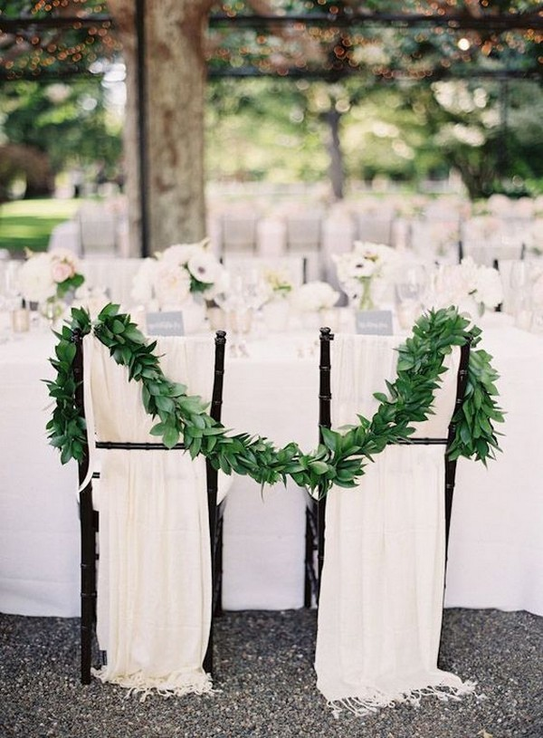 chic elegant greenery and fabric decorated wedding chairs