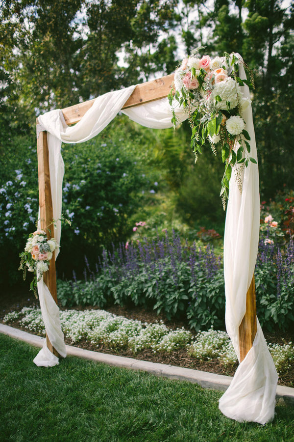 chic floral wedding arch ideas with white drapery