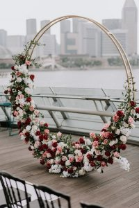 chic modern floral circular wedding arch ideas