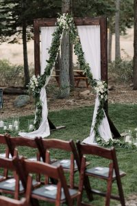chic rustic outdoor wedding arch with eucalyptus garland and flowers