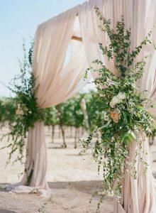 draped romantic blush and greenery wedding ceremony arch
