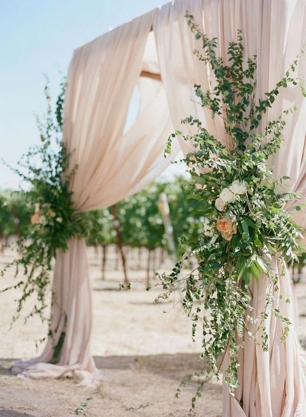 draped romantic blush and greenery wedding ceremony arch