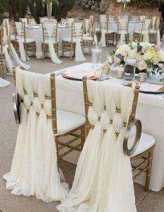elegant gold wedding chair decoration ideas with ivory fabric