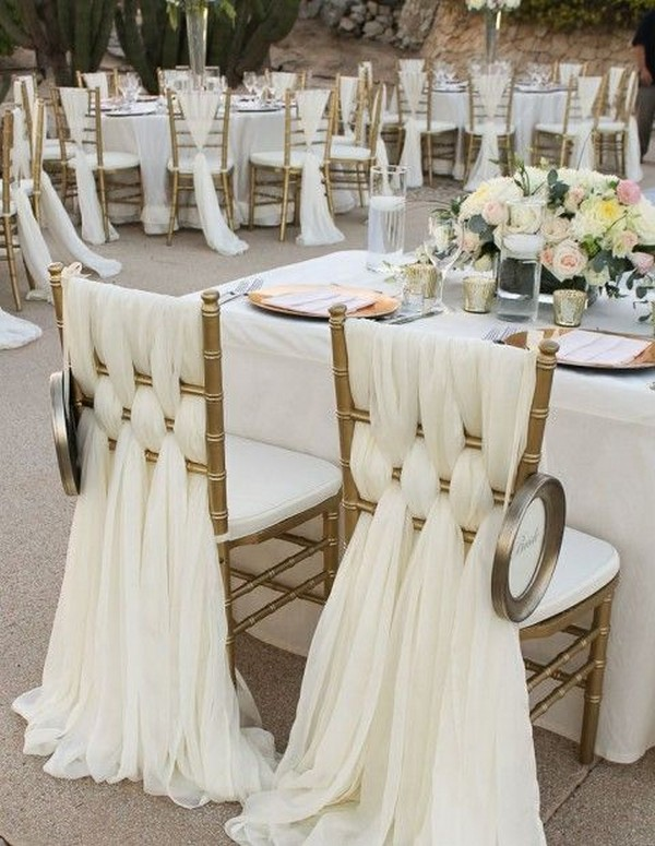 elegant gold wedding chair decoration ideas with ivory fabric