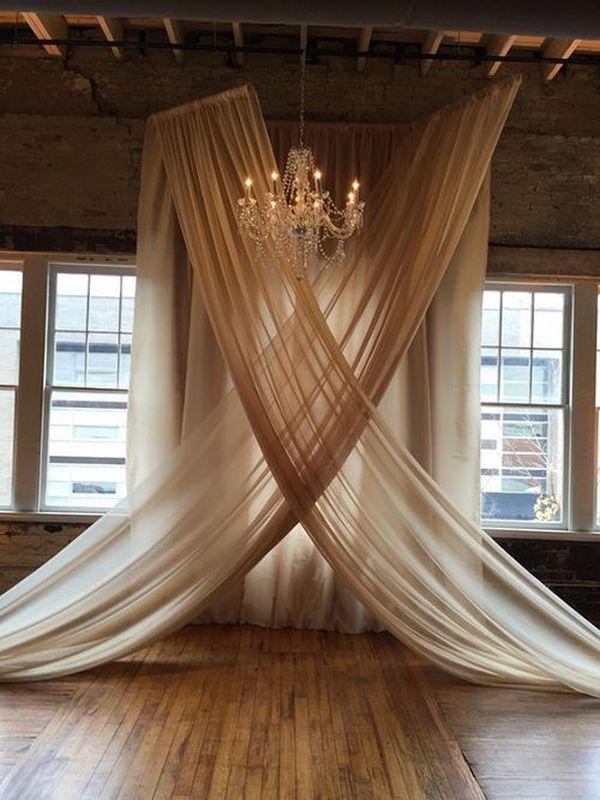 elegant wedding backdrop ideas with chandelier and chiffon drapery