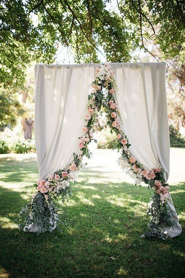 gardern wedding arch ideas with garland