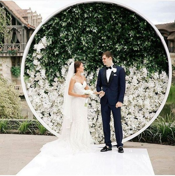green and white circular wedding arch