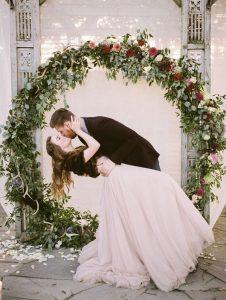 greenery and floral circular wedding backdrop ideas