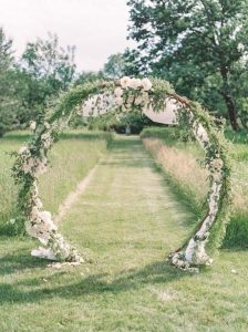 greenery and white circular floral wedding arch