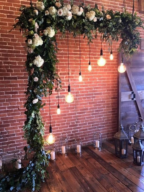 industrial wedding arch ideas with greenery and Edison Bulbs