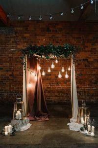 industrial wedding ceremony backdrop ideas with Edison Bulbs