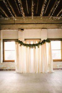 ivory drapery and greenery wedding backdrop ideas