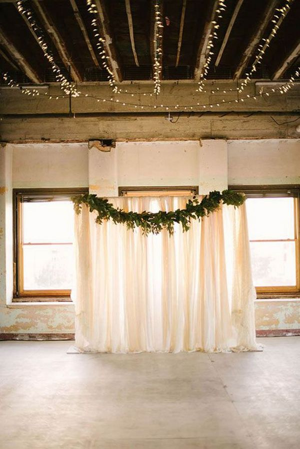 ivory drapery and greenery wedding backdrop ideas
