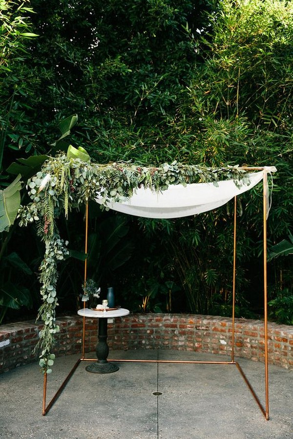modern industrial wedding arch with garland