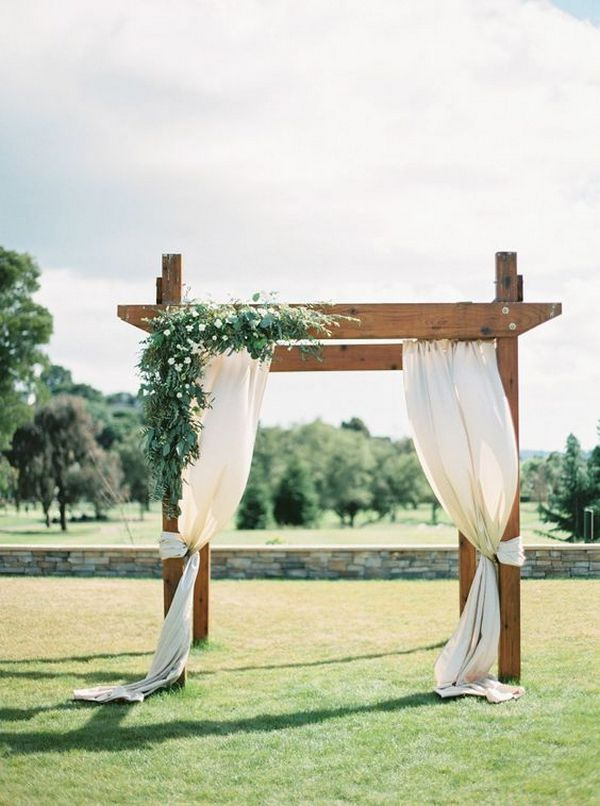 outdoor draped wedding ceremony arch