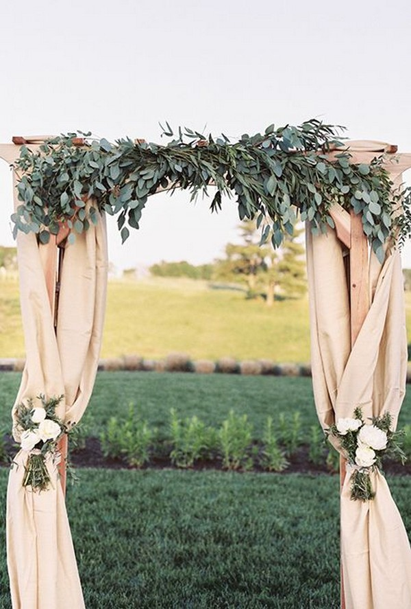 outdoor wedding arch ideas with garland and fabric