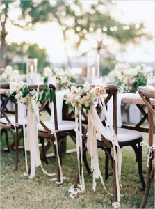 outdoor wedding chair decoration ideas with floral and ribbons